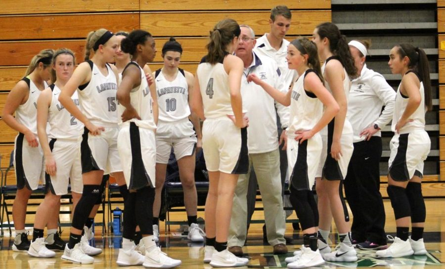 During+a+Dec.+1+game+against+Marquette%2C+the+girls+basketball+team+huddles+around+their+former+coach+to+discuss+their+game+plan.+The+Lady+Lancers+fell+to+the+Mustangs+losing+50-51.++This+season.+the+Lady+Lancers+will+take+on+Marquette+on+Feb.+7+at+home.