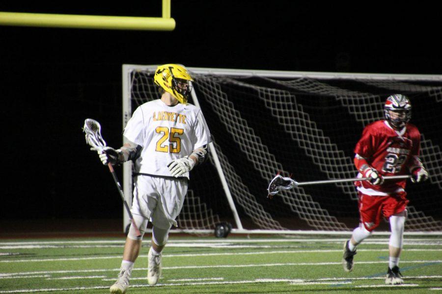 Senior+Braden+King+looks+down+the+field+towards+the+action+as+the+team+plays+Fox.