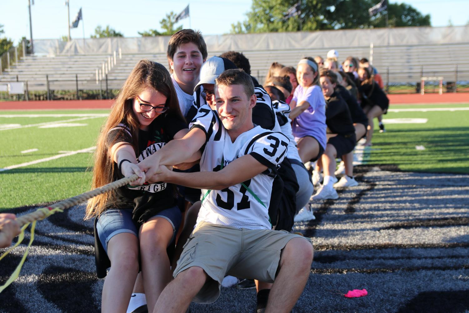 To+lead+the+juniors+to+victory+in+a+game+of+tug-of-war+at+the+Homecoming+Kickoff+on+Sunday%2C+Sept.+23%2C+Garrett+McGowan+fights+to+pull+the+rope+towards+his+class.+The++juniors+defeated+the+sophomores%2C+only+to+later+fall+to+the+senior+class.+%22I+could+feel+myself+slipping%2C+and+I+didn%27t+want+to+lose%2C+but+I%27m+glad+the+juniors+won+against+the+sophomores%2C%22+McGowan+said.