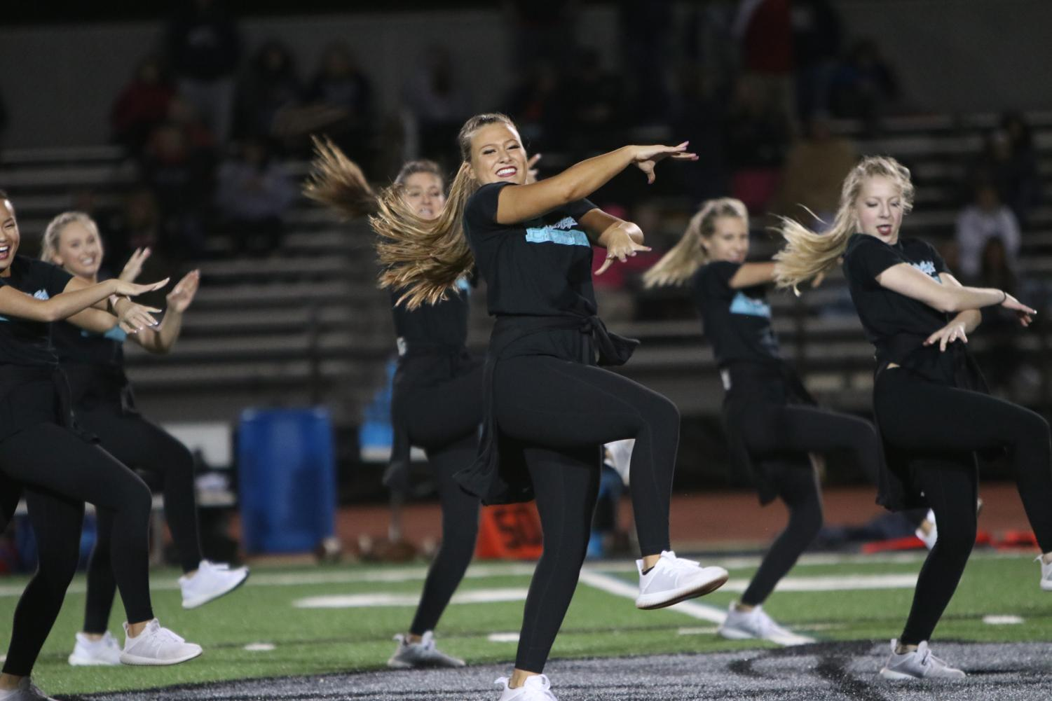 Alongside+both+JV+and+varsity+escadrille%2C+Payton+Brown%2C+sophomore%2C+performs+on+Friday%2C+Sept.+28+during+the+halftime+performance+of+the+varsity+football+game+against+the+Parkway+South+Patriots.+The+Lancers+ended+up+defeating+the+Patriots+19-8.+%22It%27s+a+little+bit+nerve-racking+%5Bto+dance+at+halftime%5D+at+first%2C+but+once+I%27m+out+there+with+everyone+it%27s+really+fun+because+we+are+all+really+close+as+a+team%2C%22+Brown+said.