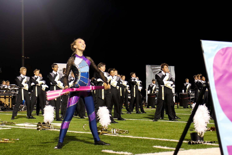 Sara+Morgenthaler+finishes+Color+Guard%27s+performance+in+Steps+with+the+Lancer+Regiment+at+halftime.