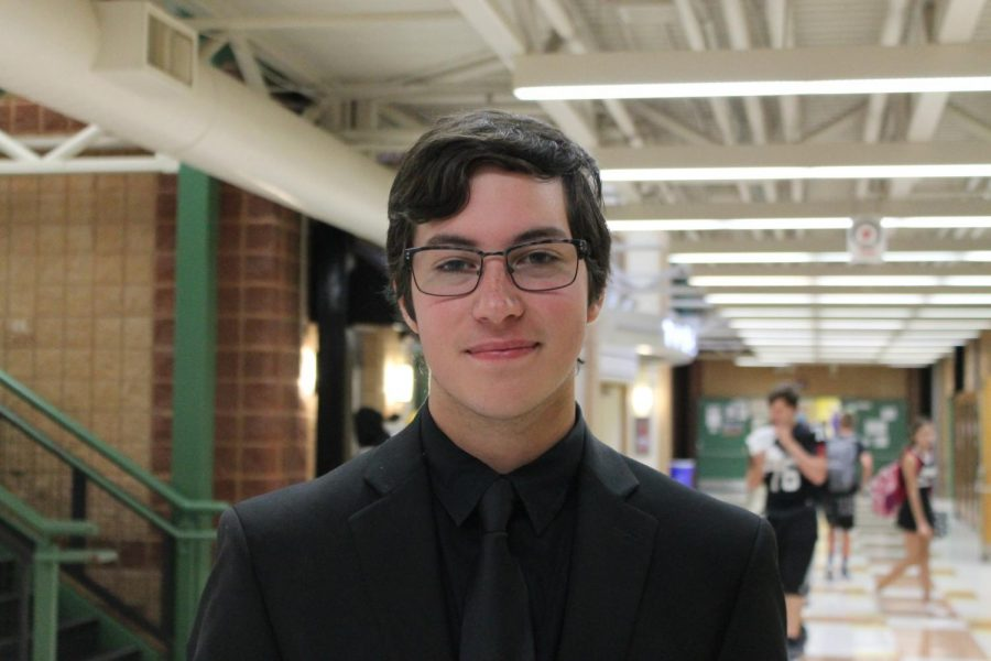 Dressed+in+his+Jazz+Band+concert+attire%2C+senior+Noah+Korenfeld+performs+the+trombone+during+lunch+on+the+Friday+of+Homecoming.