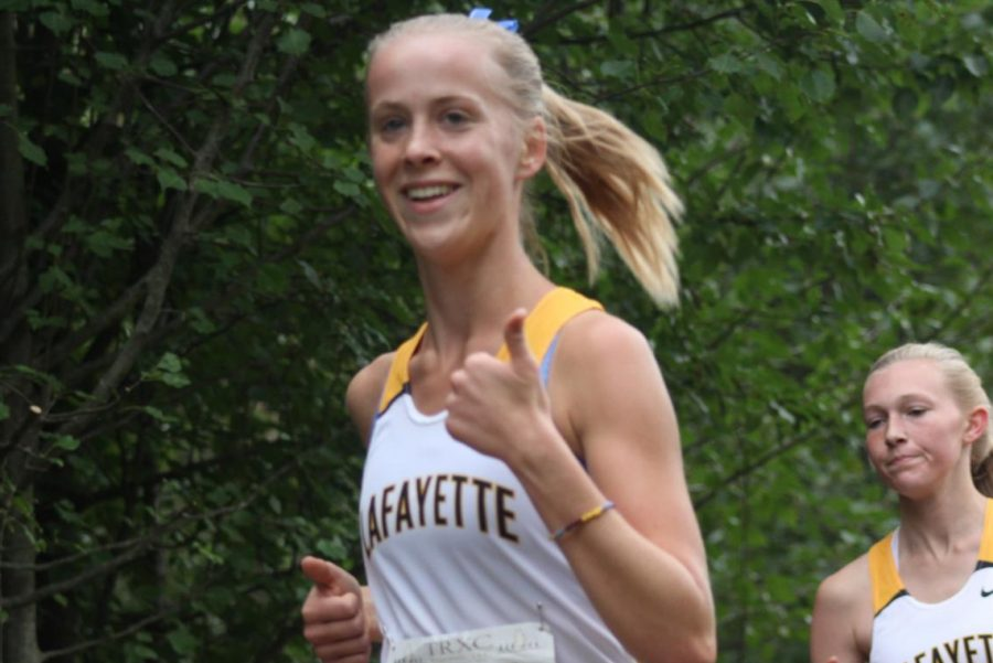 Running in the Parkway West Invitational at Living Word Church, senior Anna Karner expresses her enthusiasm. Karner finished sixth in the race on Sept. 29, and this weekend, on Nov. 3, she will race in the State Championship Meet.