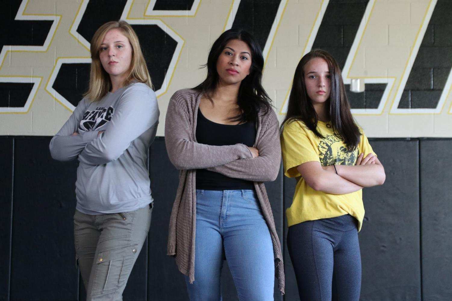 Junior Emma Cole, Head Coach Berenice Blanco and freshman Faith Cole will be leading the girls wrestling team in their first season as a state sponsored team.