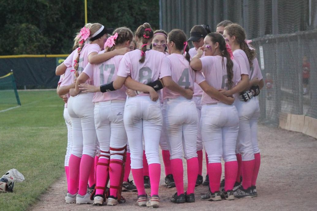 Before the Oct. 2 girls softball Pink Game at the Ellisville Athletic Association, the Lady Lancers gather in a huddle. The team fell to Marquette 0-8, so their record is now 12-11.