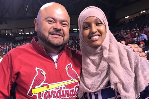 Polo Ascencio, Spanish broadcaster for the St. Louis Cardinals and Sumaya Sheikh , ESOL student attend a Cardinals game.