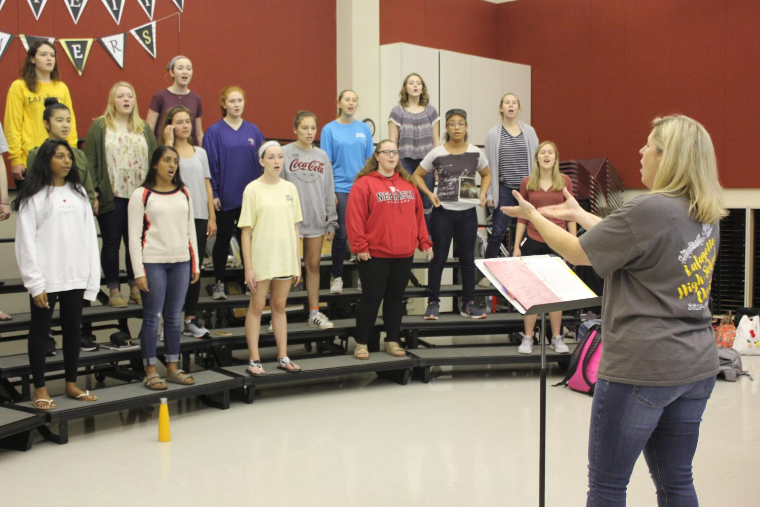 During 4th hour, choir teacher Christy Shaffer directs the Treble Chamber choir as they sing the song