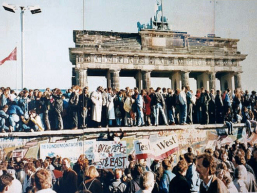 Citizens of East and West Berlin celebrate the fall of The Berlin Wall.