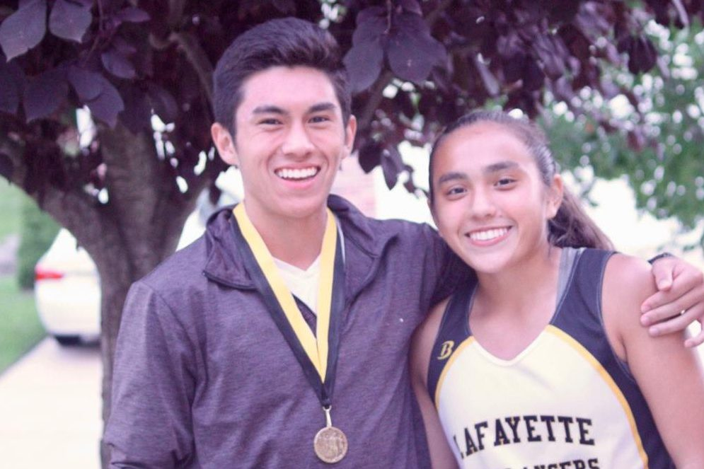 After a cross country race during the 2016-2017 season, Kayla and her brother, Cameron, celebrate the successful race. Kayla and Cameron ran cross country together while they were both at LHS.