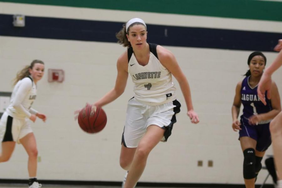 Initiating+a+fast+break%2C+senior+Tara+Robbe+dribbles+down+the+court+during+a+Nov.+30+game+against+Fort+Zumwalt+West.+Despite+the+Lady+Lancers%27+38-29+loss%2C+Robbe+was+named+to+the+All-Tournament+Team+along+with+junior+Madison+Chester.+