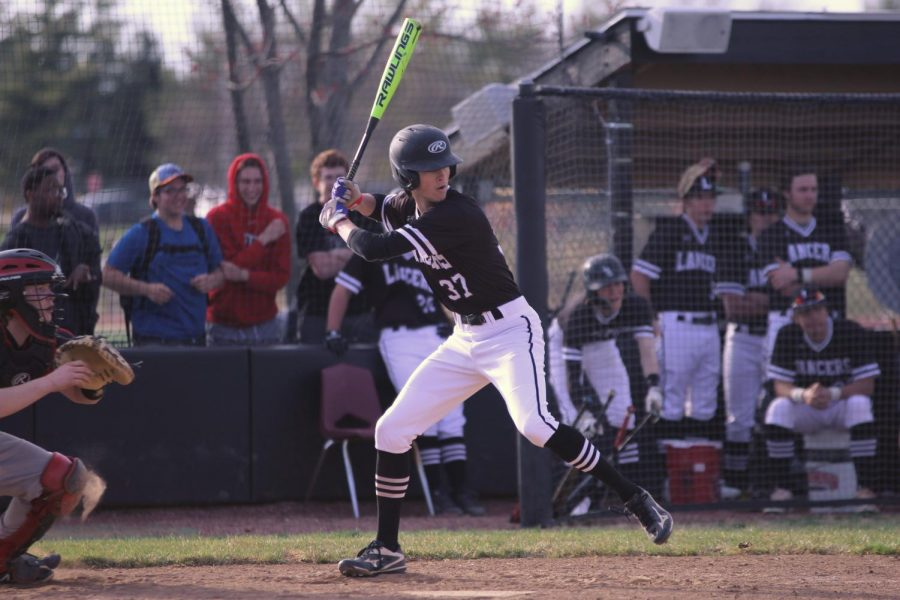 Junior Zach Bryce loads his bat to hit the ball. Bryce currently has a .500 batting average along with three hits.