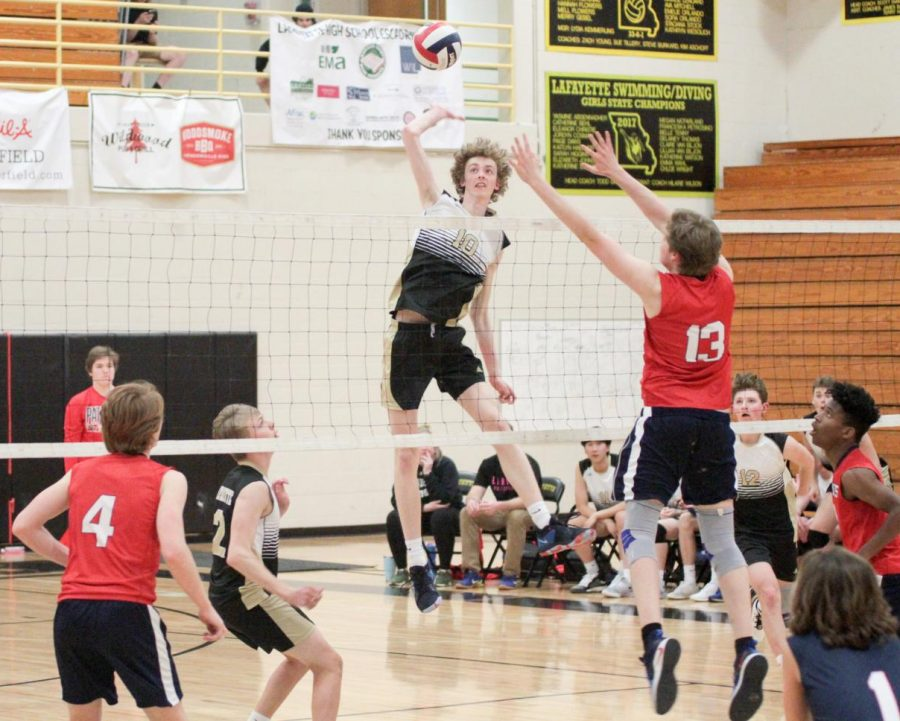 Elevating above the net, senior James Henneberry prepares to hit the ball during the Lancers match on April 2 against Parkway South. The boys volleyball defeated the Patriots in three sets.