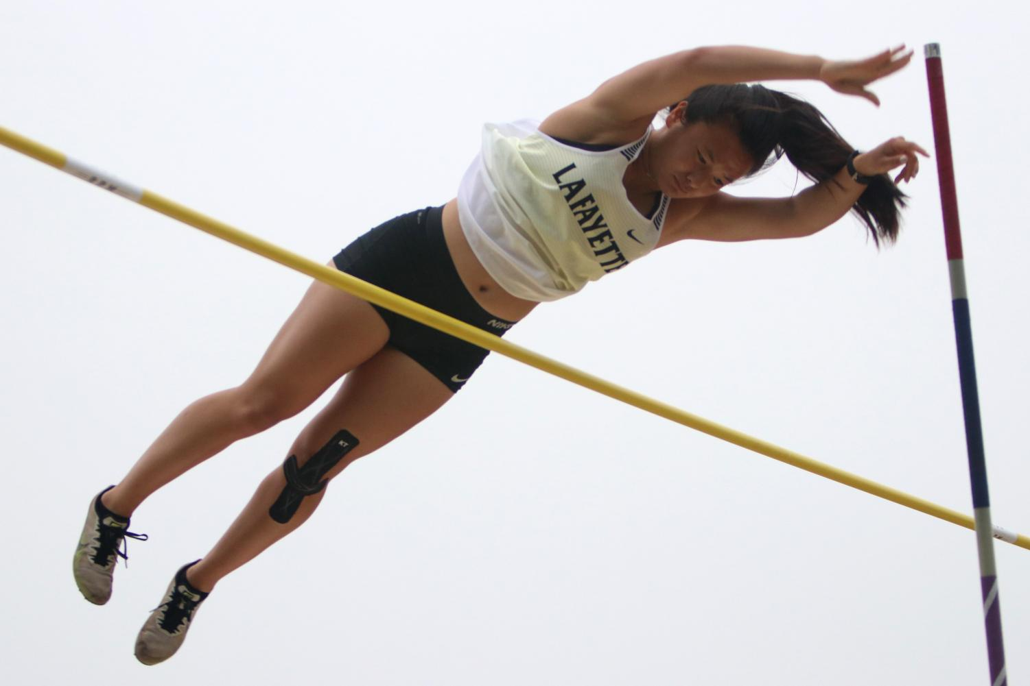 While+competing+in+pole+vault%2C+senior+Ellie+Schilling+leaps+over+the+bar.+After+breaking+the+school+record+in+pole+vault+three+times+this+season%2C+Schilling+claimed+the+fist+place+Suburban+Yellow+Conference+title+in+the+event+by+clearing+the+bar+set+at+11+feet.+