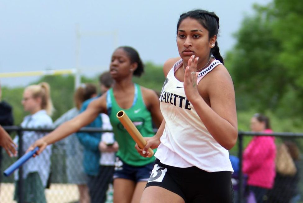 In+the+JV+girls+4+x+200+relay%2C+junior+Vrisha+Jagdish+runs+the+second+leg+of+the+race.+The+JV+relay+team+placed+fifth+in+Suburban+Yellow+Conference+Meet+with+a+2%3A00.56+finish+helping+the+Lady+Lancer%27s+JV+team+to+a+first+place+finish+in+the+meet.+