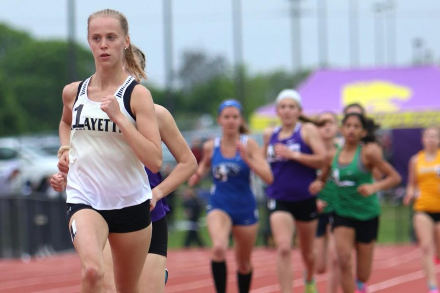 During the 1600 meter run in the Suburban Yellow Conference Meet at Lafayette, senior Anna Karner leads the pack. Karner won the race in 5:10.02 in addition to helping the 4 x 400 relay team to a third place finish.