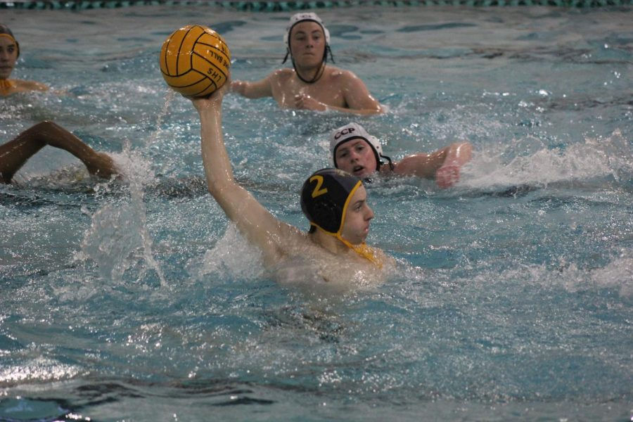 In a game against Chaminade, freshman Dylan Vorbeck looks down the pool to throw.