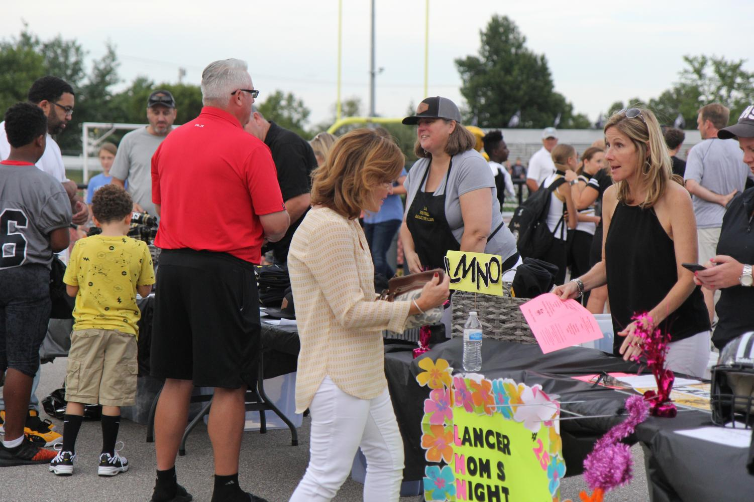 Lancer+moms+sold+new+football+and+cheerleading+spirit-wear+all+throughout+the+night.