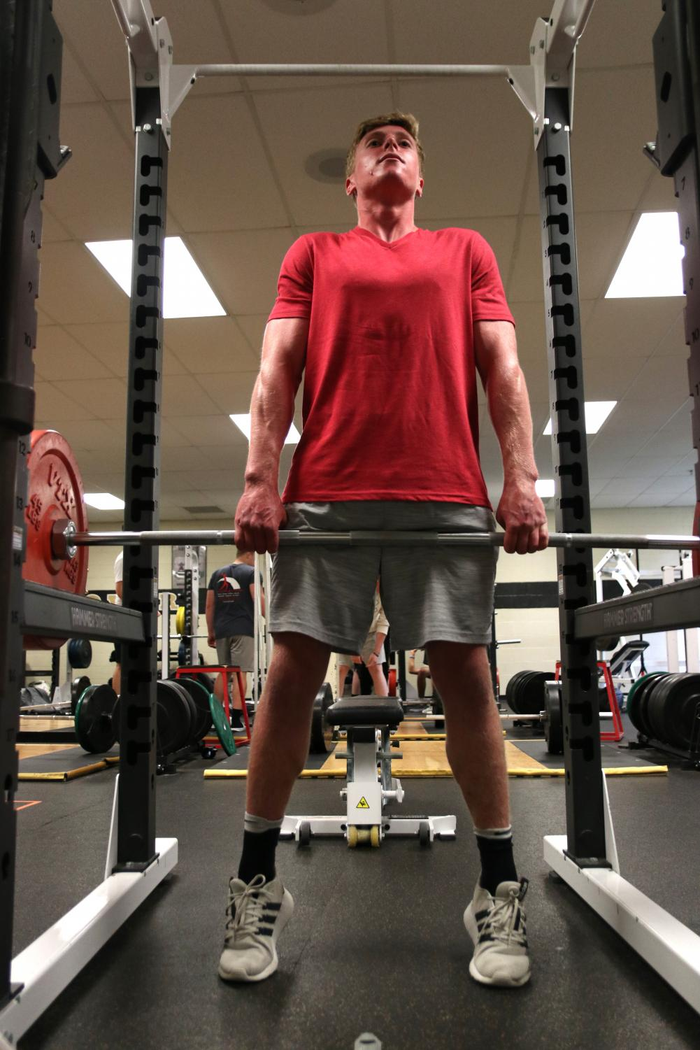 In+the+Weight+Room%2C+senior+Jake+Nelson+does+a+set+of+shrugs+during+Flex+Time.+Students+who+want+to+go+to+the+weight+room%2C+walk+the+track+or+take+part+in+other+physical+education+activities+must+be+enrolled+in+a+physical+education+class+and+can+sign+up+on+Google+Classroom+with+the+code+%22J47P3qq%22.