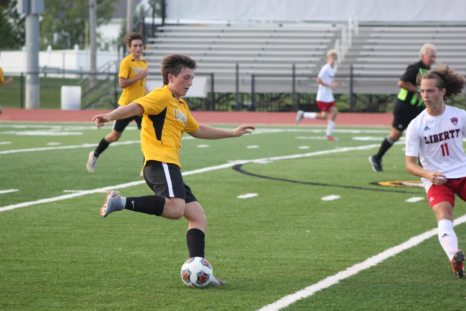 Senior Dylan Stovall prepares to kick the ball down field in a game against Liberty high school. Lancers won that game 5-0.