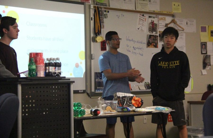 Sophomore+Arjun+Suresh+explains+to+the+club+what+their+idea+for+their+project+is.+The+project+is+to+construct+an+app+that+makes+time+management+easier+for+everyone.+