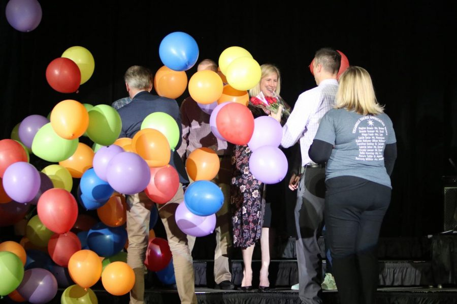 As+balloons+fall+from+the+rafters%2C+Librarian+Nichole+Ballard-Long+is+recognized+at+the+Academic+Pep+Assembly+on+March+12%2C+2019+for+being+named+the+2018-2019+Teacher+of+the+Year.