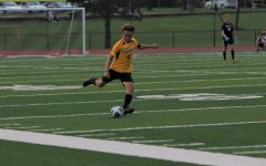 Junior Ben MacInnes prepares to kick the ball up the field in a game against Marquette on Sept. 10. The Lancers fell to the Mustangs, 3-1, but play them again in the first game of Districts on Nov. 4 at Lafayette.
