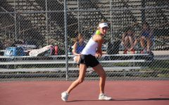 In a match against Ladue in 2018, Katie Ferguson prepares to hit the ball back to her opponent.