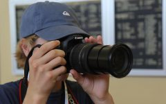 Learning the basics of photography, a journalism student practices operating a camera at a summer Herff Jones STL Yearbook Camp at De Smet Jesuit High School. Multiple camps are held each year for journalism students to hear from professionals.