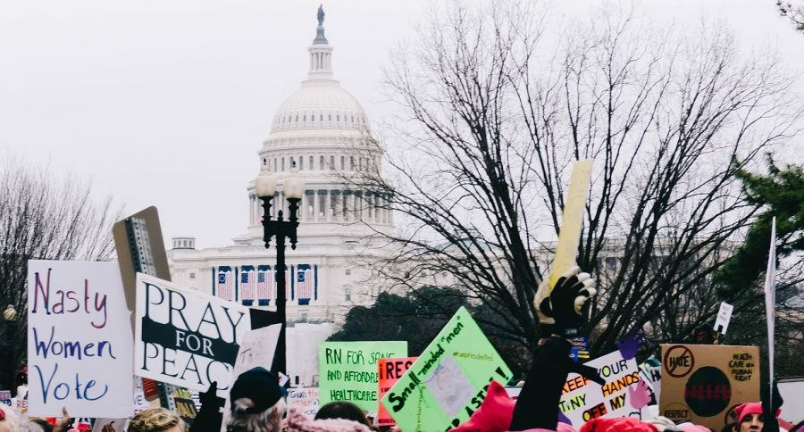 The+Women%27s+March+on+Jan.+21%2C+2017+encouraged+millions+to+march+in+protest+of+President+Trump%27s+inauguration.+A+photo+of+the+event+on+display+at+Washington%2C+D.C.%27s+National+Archives+blurred+out+words+like+%22Trump.%22+Photo+by+StockSnap%2C+licensed+for+reuse+via+Pixabay.