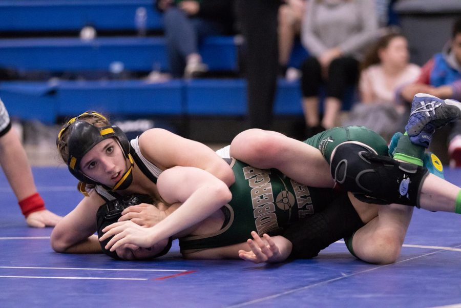 During+the+Districts+match%2C+sophomore+Faith+Cole+pins+down+an+opponent+from+Lindbergh.+Last+year%2C+Cole+won+the+State+title+in+her+weight+class.