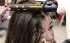 As Seen In The Image: Staffers model futuristic hair, makeup