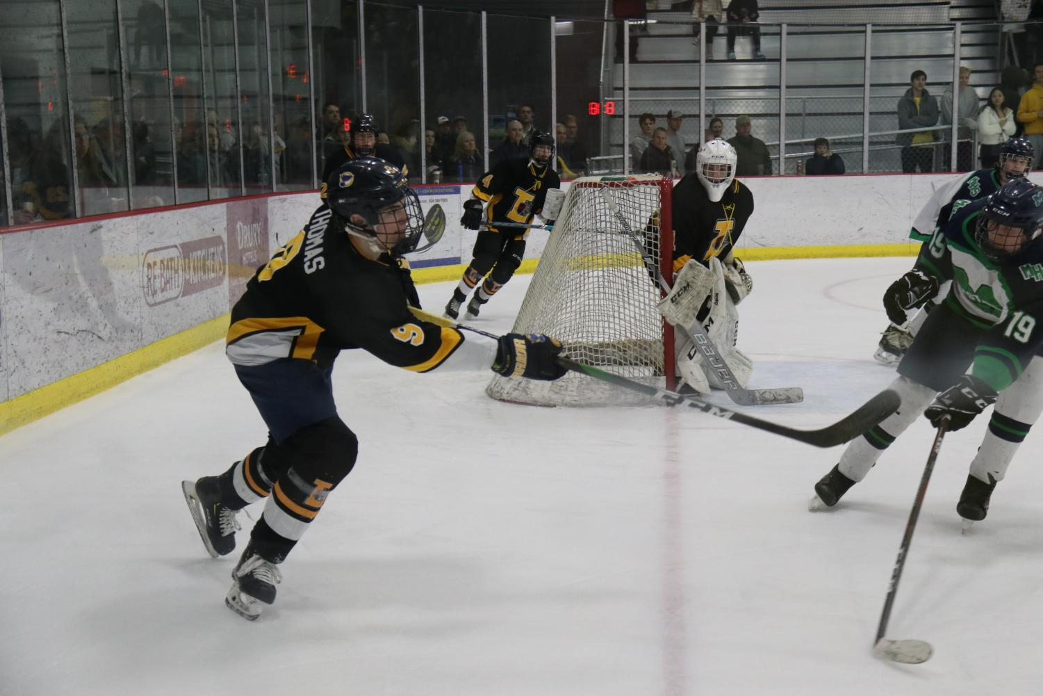 Junior, Jack Thomas,  helps defend the goal during the game against Marquette on Feb 10, to move on to the final four in the playoffs for the Challenge Cup.