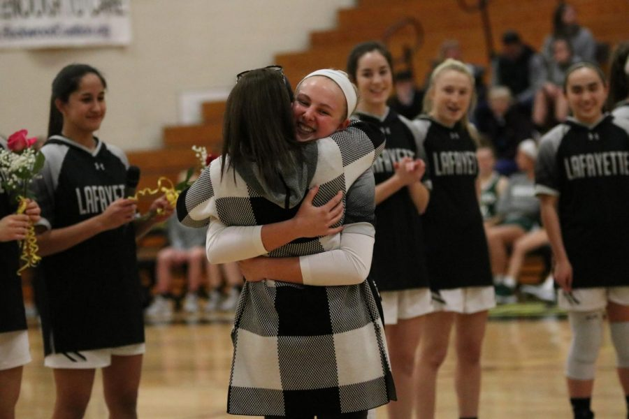 Captain Madison Chester, Class of 2020, surprised her coach, Denise Meyer, by choosing Meyer to be her SHEro during the SHEro night at girls basketball. Similar to choosing a SHEro, all students at Lafayette are encouraged to fill out the survey sent to their emails to indicate a trusted adult in the building. Trusted adults can range from any staff member that they feel safe with, including coaches they may have.
