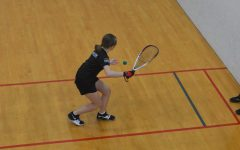 Sophomore Hannah Werk serves a ball in a duos match in 2019's National racquetball tournament.
