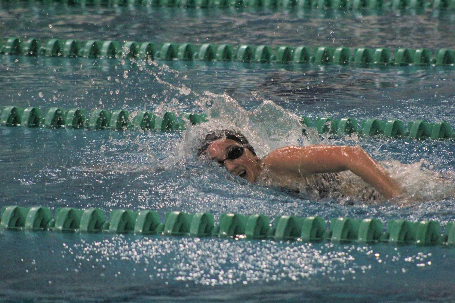 In a swim meet against Marquette High School on Jan. 28, sophomore Dylan Moulton competes in order to get her fastest time of the season. The Lady Lancers ended up losing the meet 110-76.
