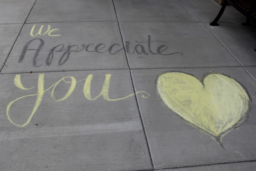Staff+members+were+greeted+to+the+building+the+second+week+with+some+positive+chalk+messages+from+some+members+of+the+Class+of+2024.+