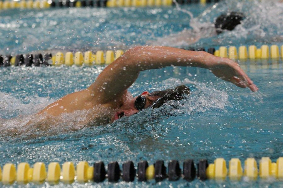 Freshman Caleb Warner digs in to his stroke during a boys swimming and diving team practice. Starting Sept. 14, sports that were classified as low-contact were allowed to participate in games or meets. The boys swimming and diving team is one of them, and they won their first meet against Wentzville Liberty, 138-45.