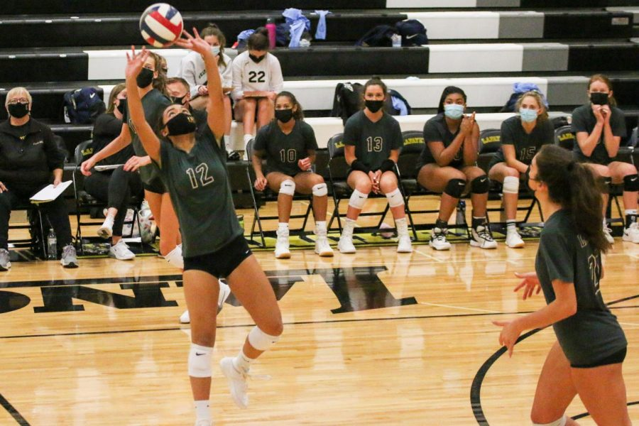 Senior Jenny Nguyen jumps up to set the ball in the Lancer's game against Borgia on Oct. 13. This was the only game the team has lost this season, but they have the possibility to play them again should they make it deep into playoffs.