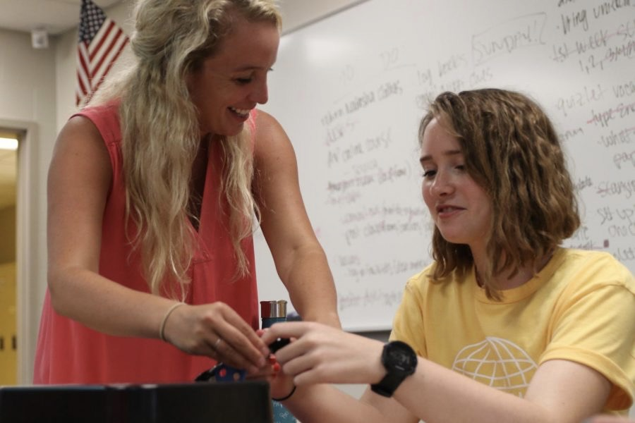 During former Latin teacher Emelia Osborne's Latin class, senior Brigid Ogle works on a breakout box project with the help of Osborne.