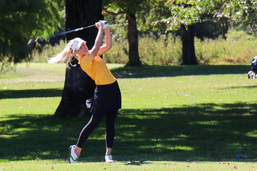 In a match, senior Brooke Biermann drives the golf ball up the course. Biermann placed second at the Missouri State High School Activities Association (MSHSAA) State tournament, shooting three under par in inclement conditions. Biermann