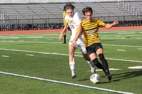 In a game against Vianney on Oct. 2, senior Luc Fladda dribbles around an opponent to get the ball upfield. The Lancers lost in their match against Vianney 3-1, with the only goal being scored by senior Mitchell Grant.