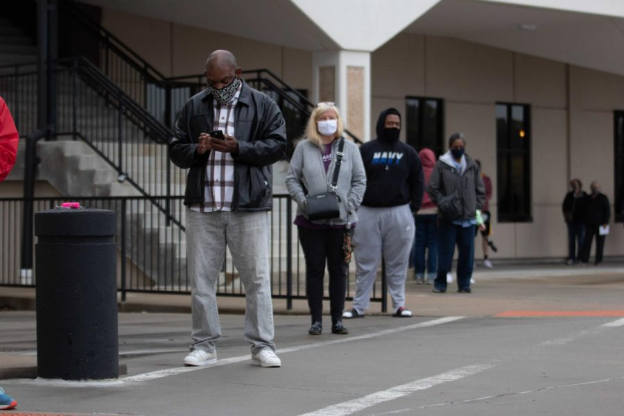 On Oct. 21, St. Louis County voters line up outside of the St. Louis County Board of Elections in order to cast their absentee ballot. Along with the ability to cast their ballot in person, voters also had the option to drop off absentee ballots.