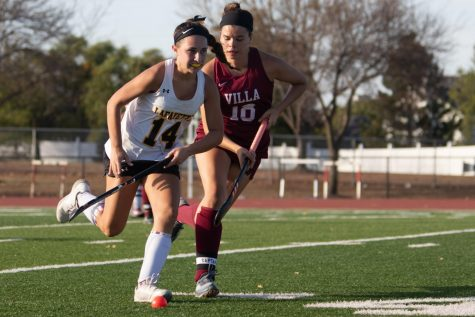 Freshman Olivia Williams moves the ball down the field on Oct. 14 in the Lancers 2-0 loss to Villa Duchesne.