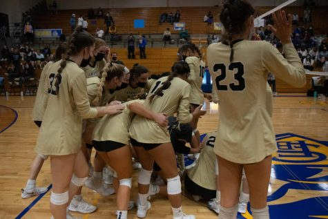 After the Oct. 27 victory against the Eureka Wildcats, the Lancers run into a group hug to celebrate their win.