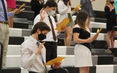 Junior Andrew Balice recites the NHS oath during the induction ceremony on Nov. 19. The event was moved into the Gym to allow the students to maintain proper distancing in the bleachers.