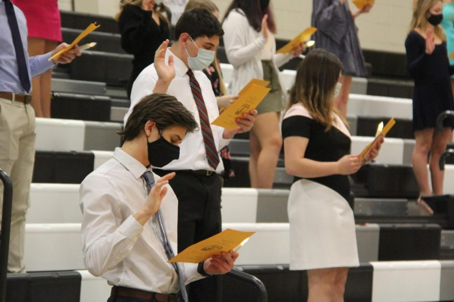 Junior+Andrew+Balice+recites+the+NHS+oath+during+the+induction+ceremony+on+Nov.+19.+The+event+was+moved+into+the+Gym+to+allow+the+students+to+maintain+proper+distancing+in+the+bleachers.