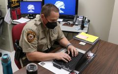 Lafayette High School's Resource Officer Chad Deakin works at his desk on Dec. 12 at Lafayette.