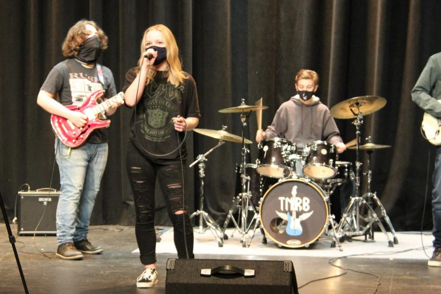 Junior Rachel Vishion performs on Dec. 15 during the filming of a music video produced by Tuesday Night Rock Band. Due to the restrictions put in place, the band has been forced to find new ways of sharing their music.
