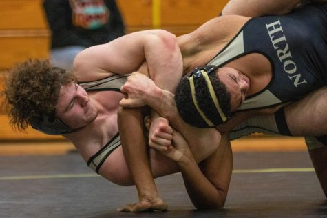 Junior Tommy Hagan works to get back points by doing a power half on his opponent. Hagan went on to win the Francis Howell North tournament in his weight class. The Lancers also won the whole tournament, beating a few other teams with a total of 210.5 points.
