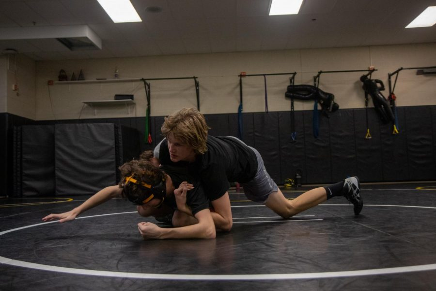 In a scrimmage against one of his teammates, junior Jack McDonald battles to keep his opponent down. McDonald won his first match of the season against Timberland, and the team won 68-12.